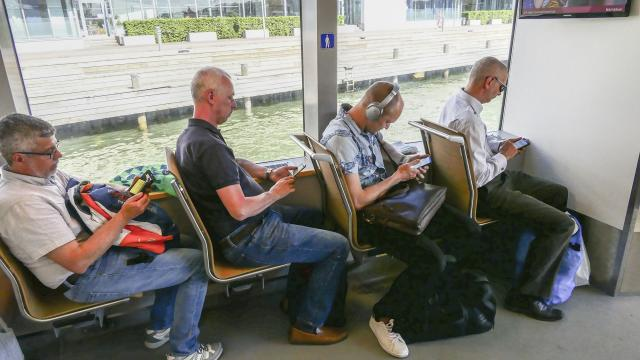 crowd on smartphone in public transport